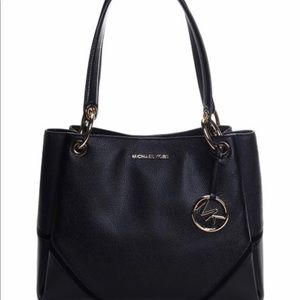 Like new black Michael Kors bag with tag attached